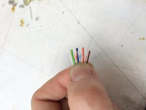 Cat 5 cable with stripped end.
